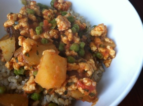 Ground chicken, potatoes, peas & tomato sauce